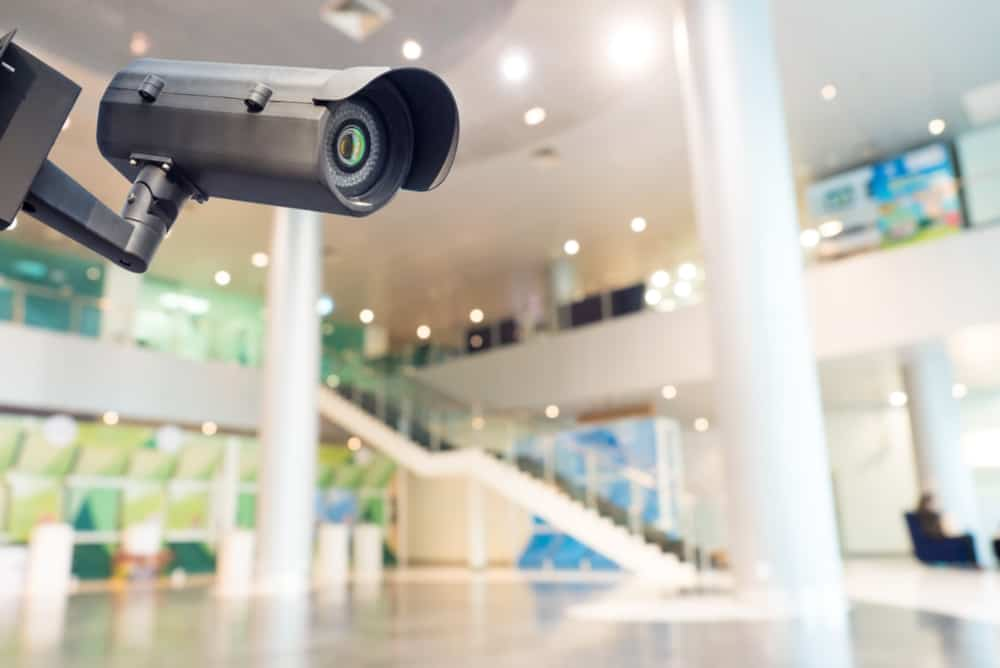 Security camera in commercial building entrance.