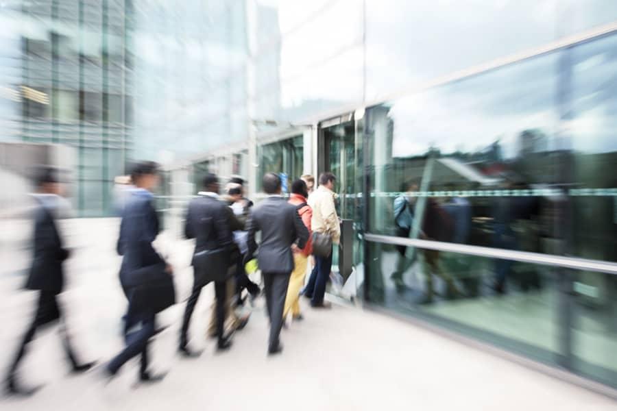 People entering commercial building entrance.
