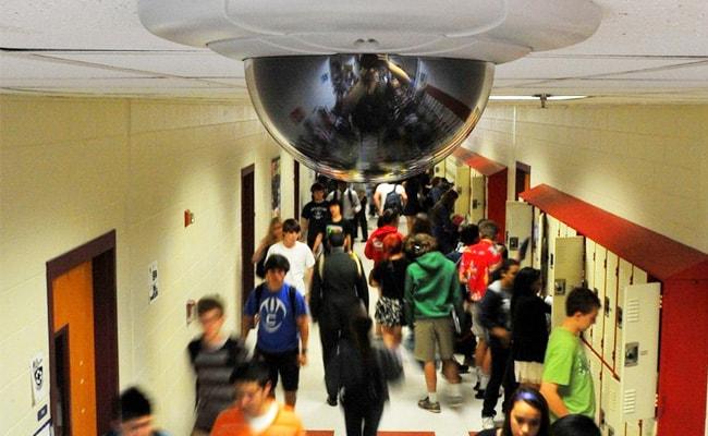 School hallway lockers security camera.