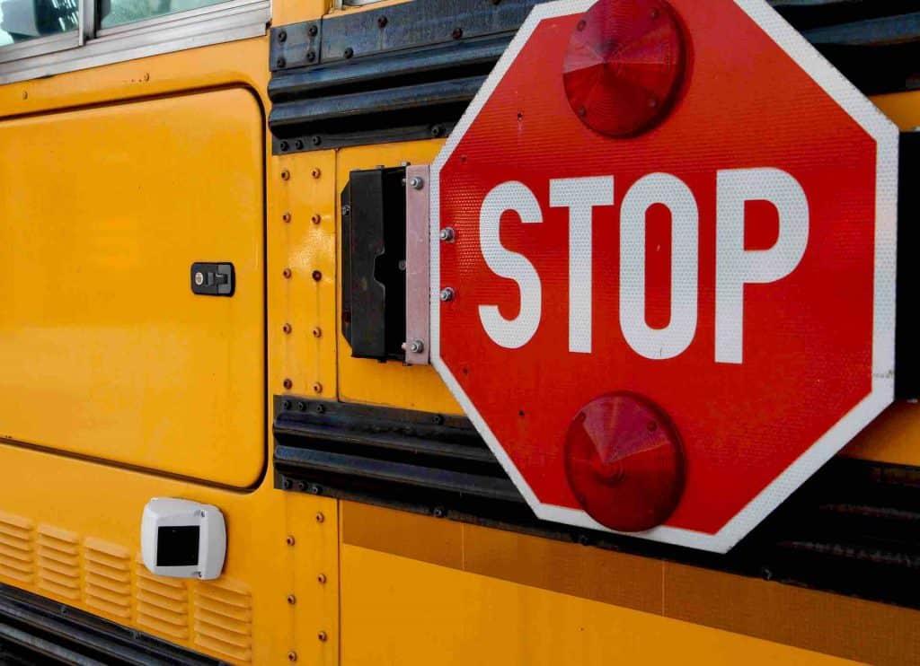 Yellow school bus stop sign.