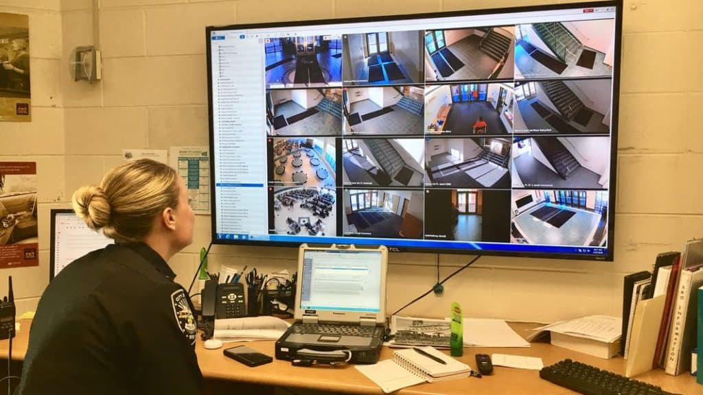 School security officer viewing security cameras.
